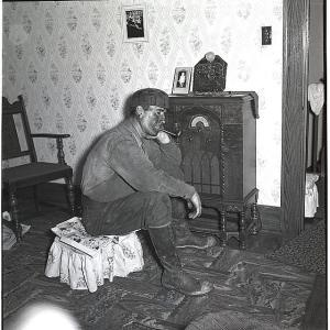man listening to radio